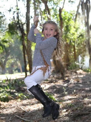 Cali Trepkowski, 8, is undergoing chemotherapy treatment in Jacksonville for brain cancer as her family supports her. Her father, Dave, is the head girls' soccer coach at Fort Myers High.