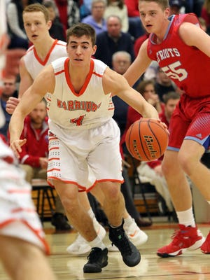 Sam Siganos of Washington looks for an opening in the lane during Thursday night's game against Lincoln in the Warrior gym.