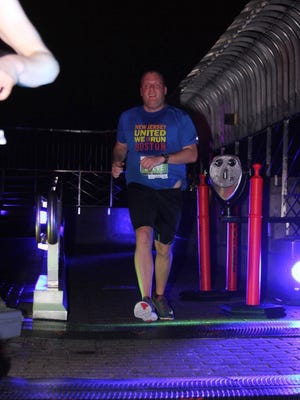 Ocean Township's Steve Clayton finishes the Empire State Building Run-Up