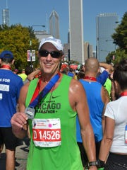 Steven Heithoff poses after completing the Chicago Marathon