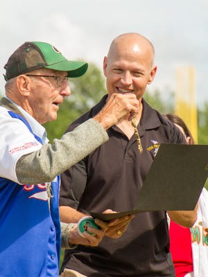 Roger Johnson receives an honorary key to Joannes Stadium from Green Bay Alderman Bill Galvin at a surprise birthday ceremony for Johnson at a Bullfrogs game Sunday.