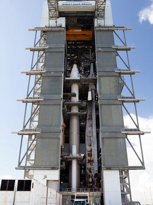 The OSIRIS-REx spacecraft, enclosed in a payload fairing, is positioned atop a United Launch Alliance Atlas V rocket at Launch Complex 41 at Cape Canaveral Air Force Station. The spacecraft will be sent to rendezvous with, survey and take a sample from an asteroid called Bennu.