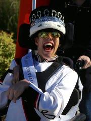 Plymouth High School senior Trenton VanderSande beams Oct. 7 after being crowned homecoming king.