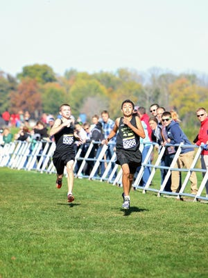 Javin Robinson runs during the Middle School State Championships on Oct. 23rd.