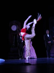 A doll created by Drosselmeyer dances for guests at