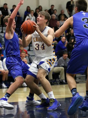 Tyler Hayes of O'Gorman looks to put a shot as Lee Vande Kamp of SF Christian defends during Tuesday's game in Sioux Falls.