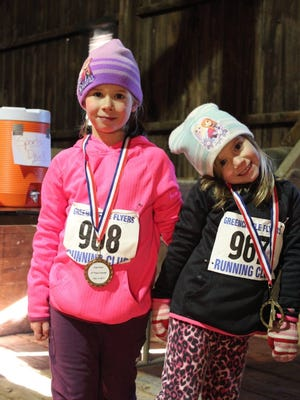 Greencastle's Lily Black, left, and her younger sister Daisy pose for a photo after competing in last weekend's Groundhog Jog one-mile kids race, which was held on the Antrim Township shared-use trail.