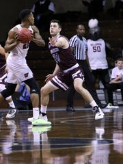 George Knott of Bellarmine applies defensive pressure to Thomas Wimbush of Fairmont State during Thursday's semifinal game at the DII Championships in Sioux Falls.