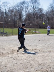 This player rips a line drive down the left-field line at Inglenook Park.