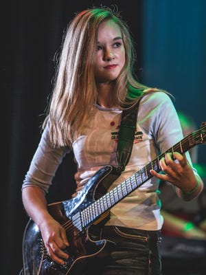 """Sydney Wolf played with the band """"The Lovely Madness"""" in the 2016 School of Rock concert."""