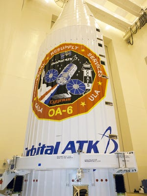 At Kennedy Space Center in February 2016, an Orbital ATK Cygnus cargo spacecraft was prepared for encapsulation in an Atlas V rocket's nose cone ahead of its launch to the International Space Station.