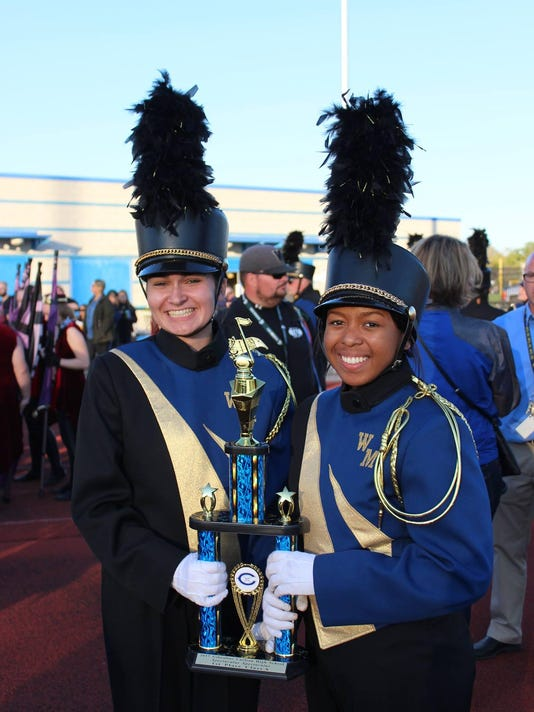 WMHS Marching Band Drum Majors with trophy