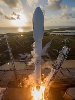 A SpaceX Falcon 9 rocket blasted off last May with a classified mission for the National Reconnaissance Office. On Friday, SpaceX test-fired the same booster's nine main engines in preparation for a targeted Tuesday afternoon launch of GovSat-1 from Cape Canaveral Air Force Station.