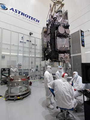 In a clean room at Astrotech Space Operations in Titusville, technicians and engineers monitored progress as NOAA's Geostationary Operational Environmental Satellite-S, or GOES-S, was mated to its payload attach fitting. The satellte on Friday morning was moved to Launch Complex 41 at Cape Canaveral Air Force Station for mounting atop the United Launch Alliance Atlas V rocket that will boost the satellite to orbit March 1.