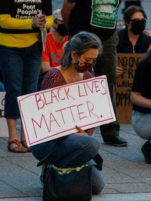 Julie Mallozzi takes a moment of silence during the Black Lives Matter rally on Sunday, August 30.