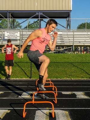 Knoxville High School's Jonas Shragal, an upcoming senior, goes through footwork speed drills at Dennis Larson Field on Wednesday morning. Watching in the background is Ryan Sunderland, who will also be a senior this fall.