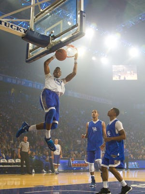 Marcus Lee slam dunks the ball during a scrimmage game  at Big Blue Madness event at Rupp Arena. October 17, 2014.