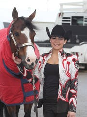 Newark Catholic graduate Lauren Diaz recently became Auburn's all-time leader in Horsemanship wins.