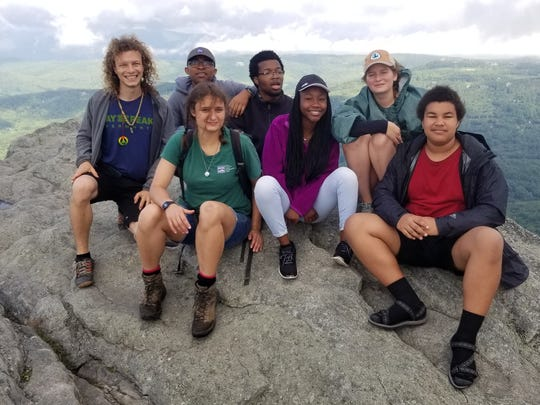 From left, Kevin Conley, Roman Watson, Brian Allison, Comfort Johnson, and Kate Kulinski. In front from left: Lyra Aquino, and Branson Williams, the seven-member NC Youth Conservation Corps Pisgah Crew, enjoy a day off.