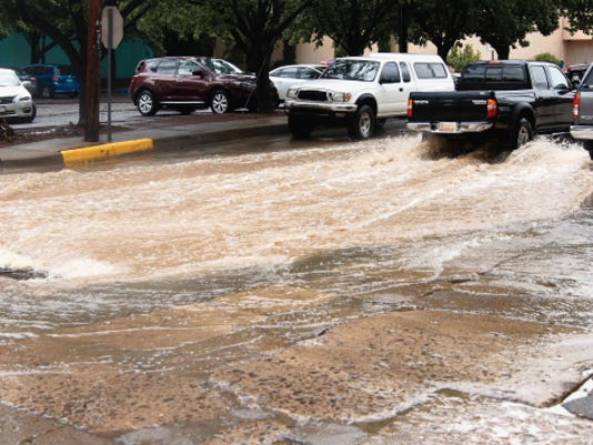 Yankie Street in Silver City turned into a canal Thursday afternoon following a thunderstorm that included hail and a lot of rain. According to weather.com, chances remain in the forecast for rain today and Saturday, but Sunday should be mostly sunny with a high of 85 degrees. Randal Seyler - Sun-News