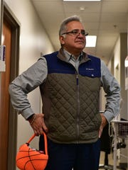 Pediatric Allergist Dr. Ray Rodriguez holds a bucket