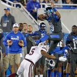QB Johnson delivers in crunch time for Cats
