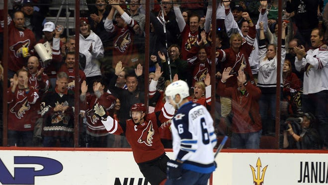 Arizona Coyotes right wing Shane Doan (19) celebrates a goal against the Winnipeg Jets during the first period at Gila River Arena. The goal by Doan was his 380th of his career and becomes the all-time Coyotes goal-scoring leader.
