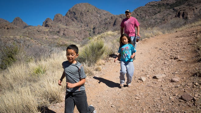 8-year-old Adrian Garza, left, 6-year-old Alyssa Garza and Larry Garza hike through the Bureau of Land Management's Soledad Canyon Day Use Area.