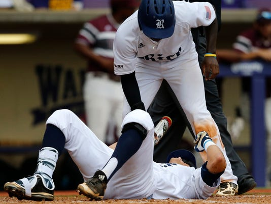 Rice's Tristan Gray lies on the ground after being hit by a pitch during the second inning inning of an NCAA college baseball tournament regional game against Texas Southern in Baton Rouge, La., Saturday, June 3, 2017. (AP Photo/Gerald Herbert)
