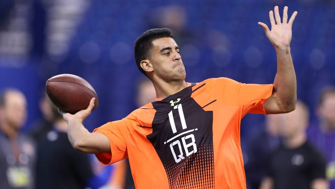 Former Oregon Ducks quarterback Marcus Mariota throws a pass Feb. 21 at the NFL Combine in Indianapolis.