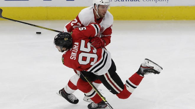 Forward Dylan Sikura, a former Rockford IceHogs star, is shown taking a shot for the Chicago Blackhawks on Jan. 5, 2020. Sikura scored his first NHL goal in that game, but hasn't gotten in yet in the two recent Hawks playoff games.