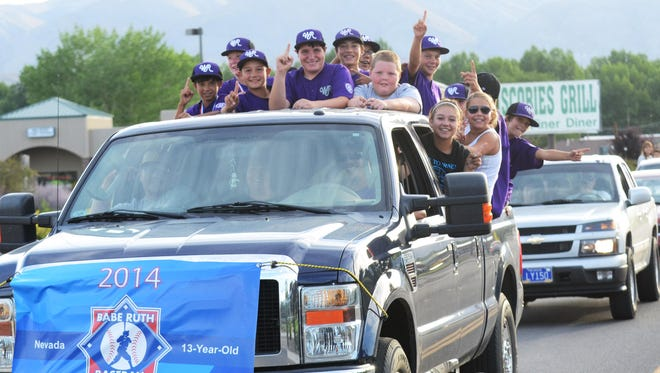 The state tournament-winning Walker River Babe Ruth 13 team parades through Yerington July 13, with police cars, firefighting apparatus and other cars accompanying them down Bridge and Main streets.