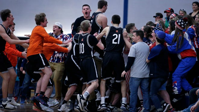The Cedarburg Bulldogs celebrate with their fans after defeating Kaukauna in a WIAA D2 sectional final Saturday, March 11, 2017, at Menasha High School in Menasha, Wisconsin.Ron Page/USA TODAY NETWORK- Wisconsin