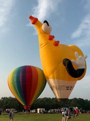 The yellow saxophone balloon at the QuickChek New Jersey Festival of Ballooning at Solberg Airport.