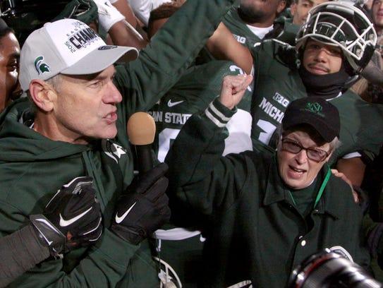 Michigan State football coach Mark Dantonio, left,