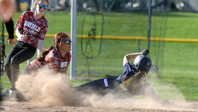 Victor's Allie DiGiacomo, right, is called safe at third under the tag of Penfield's Yarliz Santiago during regular season game played at Victor High School on Friday, May 1, 2015. Victor beat Penfield 1-0.