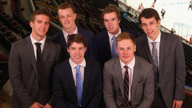 Upcoming NHL draft picks (back row, l-r) Noah Hanafin, Jack Eichel, Connor McBride and Dylan Strome, and (front row l-r) Mitchell Marner and Lawson Crouse pose for a photo opportunity during media availability at United Center on June 8, 2015 in Chicago, Illinois.