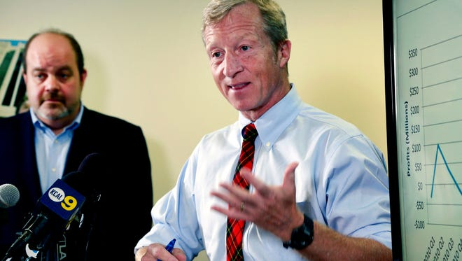 Billionaire climate activist Tom Steyer, right, speaks during a news conference with consumer advocate Jamie Court, left, president of Consumer Watchdog in Santa Monica, Calif. on Wednesday, Aug. 5, 2015. Steyer is calling on state legislators to require oil companies to disclose how much they make in profits from refining oil in California. Steyer was joined by the nonprofit Consumer Watchdog Wednesday in condemning what they called historic profits for oil refiners at the expense of consumers. (AP Photo/Nick Ut)