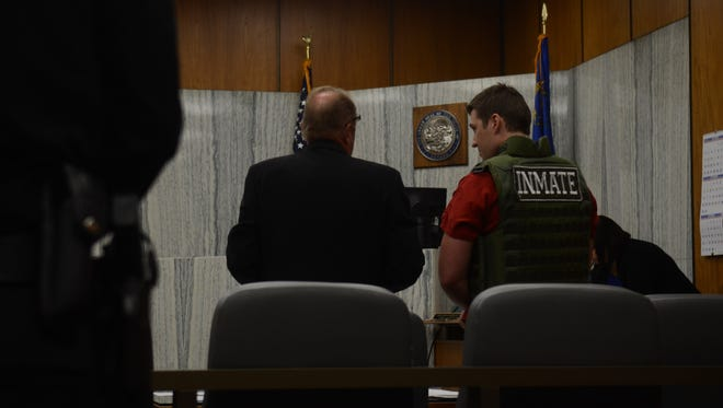 Jason Brown, 25, of Reno, talks with his attorney, John Oakes, just before his sentencing hearing on Thursday in the Washoe County District Court in Reno.
