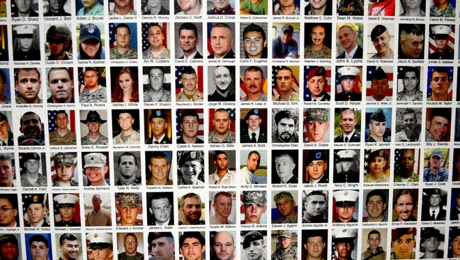 """A look at one of 35 panels with 192 photos of fallen soldiers featured in """"Always Lost: A Mediation on War."""" The war memorial is on display through Jan. 15 at the Washoe County Administration Complex in Reno."""