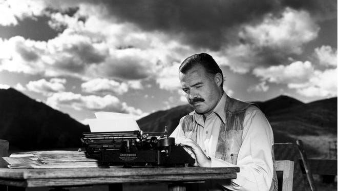 """Ernest Hemingway types on his Royal Noiseless Typewriter while working on his famous work, """"For Whom The Bell Tolls."""" Though most often associated with this typewriter, Hemingway's first was a Corona #3 made in Groton, New York, in the 1920s."""