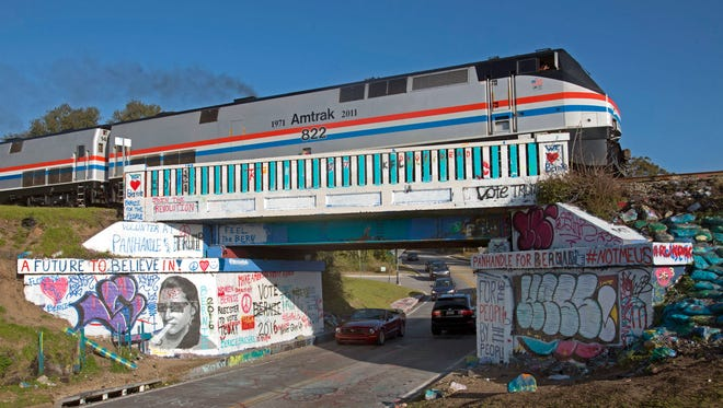 An Amtrak train once again crosses the iconic 17th Ave. railroad trestle after making a stop in Pensacola Friday morning Feb. 19, 2016. The Pensacola stop is part of the Southern Rail Commission's Gulf Coast Passenger Rail Inspection trip.