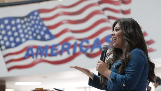 State Rep. Mary González, D-El Paso, speaks Wednesday at a news conference at Americas High School to announce the school's upcoming immigration conference. The conference will be hosted by the school's Libertas Magnet School program.