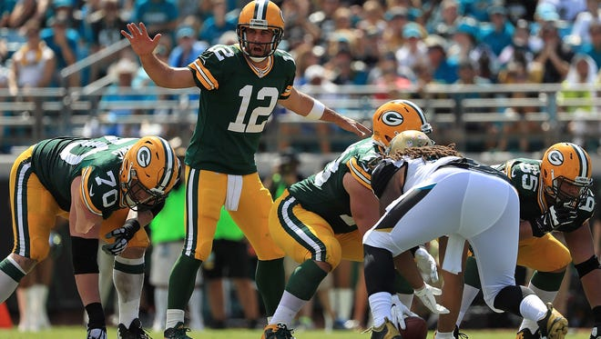 JACKSONVILLE, FL - SEPTEMBER 11:  Aaron Rodgers #12 of the Green Bay Packers calls a play during a game against the Jacksonville Jaguars at EverBank Field on September 11, 2016 in Jacksonville, Florida.  (Photo by Mike Ehrmann/Getty Images)