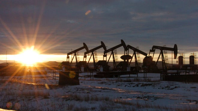 Oil pumps in North Dakota attest to the USA's growing power in the world oil market.
