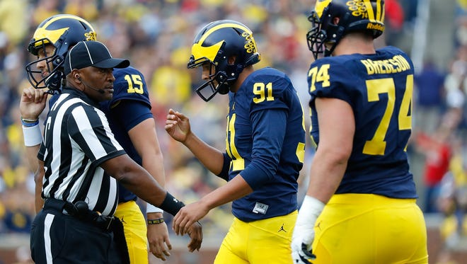 Kicker Kenny Allen (91) of the Michigan Wolverines walks back to the sideline after missing a field goal against Wisconsin on Oct. 1, 2016, in Ann Arbor.