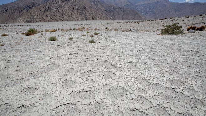The cracked dry surface of Percolation Pond 5, which is part of the system used to replenish the Coachella Valley aquifer, awaits water.