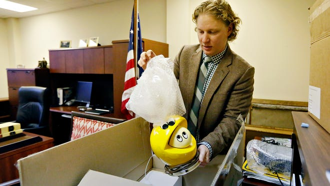 On his last day as State Representative, Kevin Schreiber unpacks a Pac Man lamp from a box in his new office as he prepares for his Dec. 1 transition into the position of President and CEO of the York County Economic Alliance in York City, Wednesday, Nov. 30, 2016. Dawn J. Sagert photo