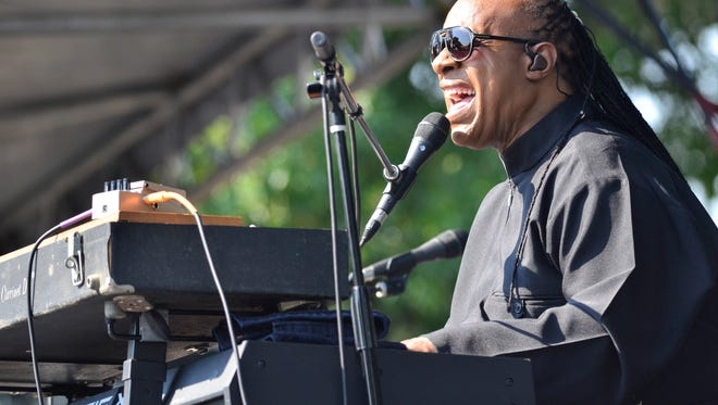 """Stevie Wonder performs during an exclusive press conference and performance on the Armory Mall on August 17, 2015 in Washington, D.C. Wonder's 1967 Christmas album included the first recording of the holiday staple, """"What Christmas Means to Me."""""""