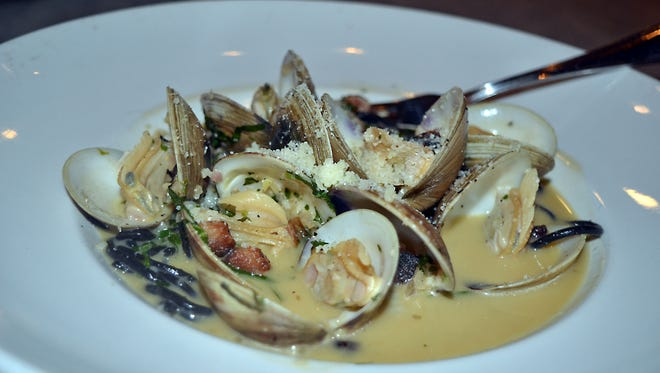 On the Parlor Market menu you can find Clams & Pancetta, which includes littleneck clams, squid ink linguine, garlic herb butter, Parmesan and red pepper flakes.